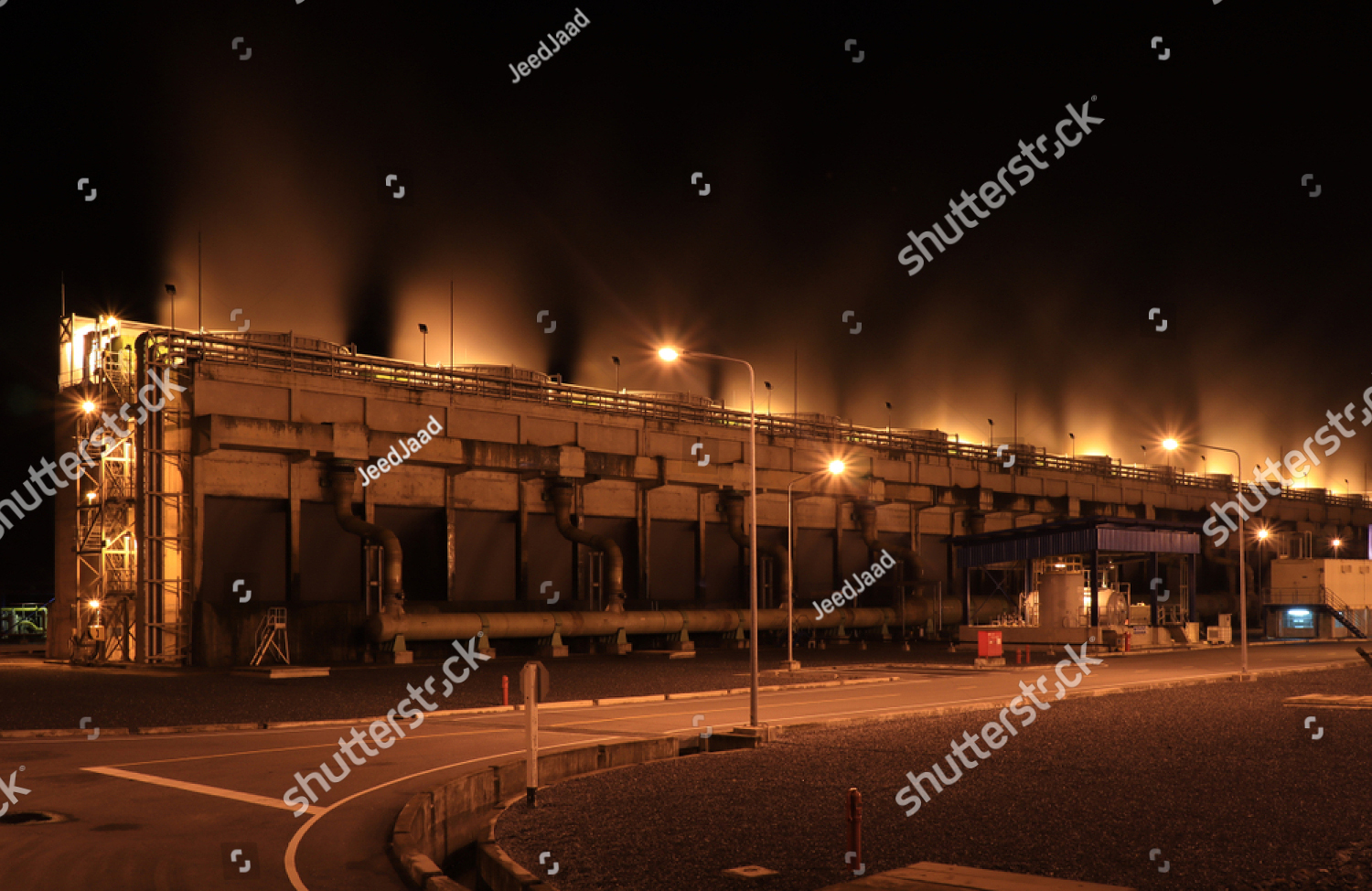 stock-photo-cooling-tower-at-night-times-cooling-tower-of-power-plant-1188435589